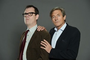 Murder On The Blackpool Express. Image shows from L to R: Kevin (Kevin Eldon), Doc (Nigel Havers).