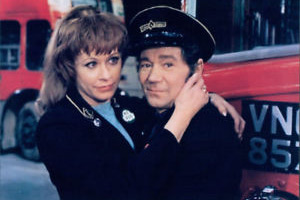 Mutiny On The Buses. Image shows from L to R: Suzy (Janet Mahoney), Stan Butler (Reg Varney). Copyright: Studio Canal.