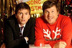 Nativity 2: Danger In The Manger!. Image shows from L to R: David Peterson (David Tennant), Mr Poppy (Marc Wootton). Copyright: Mirrorball Films.