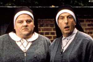 Nuns On The Run. Image shows from L to R: Charlie McManus (Robbie Coltrane), Brian Hope (Eric Idle). Copyright: Hand Made Films.