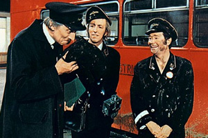 On The Buses. Image shows from L to R: Inspector Blake (Stephen Lewis), Jack Harper (Bob Grant), Stan Butler (Reg Varney). Copyright: Hammer Film Productions.