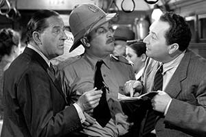Passport To Pimlico. Image shows from L to R: Arthur Pemberton (Stanley Holloway), P.C. Spiller (Philip Stainton), Central European (Paul Demel). Copyright: Ealing Studios / STUDIOCANAL.