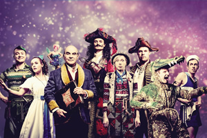 Peter Pan Goes Wrong. Image shows from L to R: Jonathan (Peter Pan) (Greg Tannahill), Sandra (Wendy) (Charlie Russell), Annie (Mrs Darling / Lisa / Tinkerbell) (Nancy Zamit), The Narrator (David Suchet), Chris (Hook) (Henry Shields), Lucy (Tootles) (Ellie Morris), Robert (Starkey) (Henry Lewis), Max (Crocodile) (Dave Hearn), Dennis (Smee) (Jonathan Sayer). Copyright: Idil Sukan.