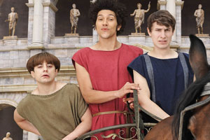 Plebs. Image shows from L to R: Grumio (Ryan Sampson), Stylax (Joel Fry), Marcus (Tom Rosenthal). Copyright: RISE Films.