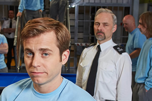 Porridge. Image shows from L to R: Fletch (Kevin Bishop), Officer Meekie (Mark Bonnar). Copyright: BBC.