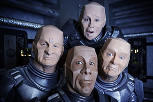 Red Dwarf. Image shows from L to R: Rimmer (Chris Barrie), Cat (Danny John-Jules), Lister (Craig Charles), Kryten (Robert Llewellyn).
