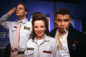 Red Dwarf. Image shows from L to R: Rimmer (Chris Barrie), Kochanski (Clare Grogan), Lister (Craig Charles). Copyright: BBC.