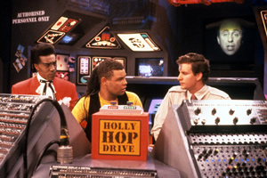 Red Dwarf. Image shows from L to R: Cat (Danny John-Jules), Lister (Craig Charles), Rimmer (Chris Barrie). Copyright: BBC.