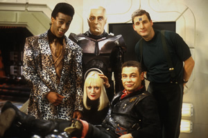 Red Dwarf. Image shows from L to R: Cat (Danny John-Jules), Kryten (Robert Llewellyn), Holly (Hattie Hayridge), Lister (Craig Charles), Rimmer (Chris Barrie). Copyright: BBC.