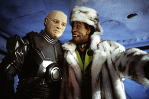 Red Dwarf. Image shows from L to R: Kryten (Robert Llewellyn), Cat (Danny John-Jules). Copyright: BBC.