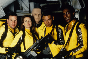 Red Dwarf. Image shows from L to R: Rimmer (Chris Barrie), Kochanski (Chloë Annett), Kryten (Robert Llewellyn), Lister (Craig Charles), Cat (Danny John-Jules). Copyright: BBC.