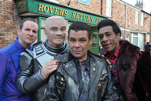 Red Dwarf. Image shows from L to R: Rimmer (Chris Barrie), Kryten (Robert Llewellyn), Lister (Craig Charles), Cat (Danny John-Jules). Copyright: UKTV.