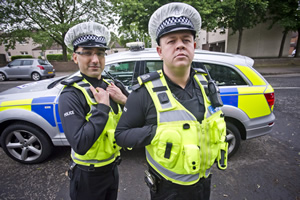 Scot Squad. Image shows from L to R: PC Surjit Singh (Manjot Sumal), PC Hugh McKirdy (Graeme Stevely). Copyright: The Comedy Unit.