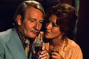 Spanish Fly. Image shows from L to R: Mike Scott (Leslie Phillips), Julie (Roswicha Honczar). Copyright: Impact Quadrant-Quadrant Films.