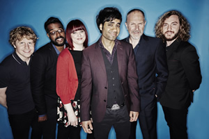 Stand Up For The Week. Image shows from L to R: Josh Widdicombe, Romesh Ranganathan, Angela Barnes, Paul Chowdhry, Simon Evans, Seann Walsh. Copyright: Open Mike Productions.
