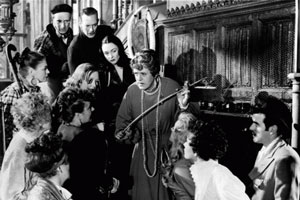 The Belles Of St. Trinian's. Image shows from L to R: Unknown, Unknown, Unknown, Unknown, Unknown, Unknown, Unknown, Unknown, Miss Millicent Fritton (Alastair Sim), Unknown, Unknown, Flash Harry (George Cole). Copyright: London Films / Studio Canal.