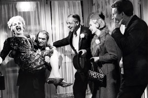The Big Job. Image shows from L to R: Mildred Gamely (Joan Sims), Frederick 'Booky' Binns (Dick Emery), George 'The Great Brain' (Sid James), Myrtle Robbins (Sylvia Syms), Timothy 'Dipper' Day (Lance Percival). Copyright: Anglo Amalgamated.