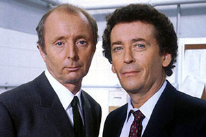 The Detectives. Image shows from L to R: Bob Louis (Jasper Carrott), Dave Briggs (Robert Powell). Copyright: Celador Productions.