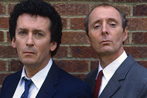 The Detectives. Image shows from L to R: Dave Briggs (Robert Powell), Bob Louis (Jasper Carrott). Copyright: Celador Productions.