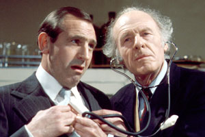 The Fall And Rise Of Reginald Perrin. Image shows from L to R: Reginald Perrin (Leonard Rossiter), Doc Morrissey (John Horsley). Copyright: BBC.
