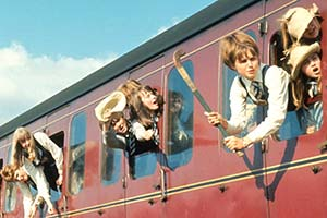 St. Trinian's girls hanging out of train carriage windows. Copyright: Braywild Limited / STUDIOCANAL.