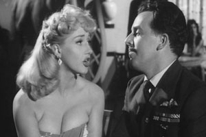 The Night We Dropped A Clanger. Image shows from L to R: Lulu (Liz Fraser), Wing Cmdr. Blenkinsop (Brian Rix). Copyright: Four Star Films.