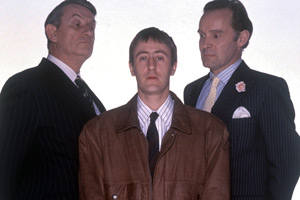 The Piglet Files. Image shows from L to R: Andrew Maxwell (John Ringham), Peter 'Piglet' Chapman (Nicholas Lyndhurst), Major Maurice Drummond (Clive Francis). Copyright: London Weekend Television.