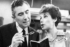 The Rag Trade. Image shows from L to R: Harold Fenner (Peter Jones), Paddy Fleming (Miriam Karlin). Copyright: BBC.