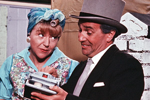 The Sandwich Man. Image shows from L to R: Mrs De Vere (Dora Bryan), The Sandwich Man (Michael Bentine).