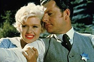 The Sheriff Of Fractured Jaw. Image shows from L to R: Kate (Jayne Mansfield), Jonathan Tibbs (Kenneth More).