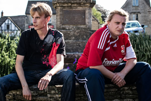 This Country. Image shows from L to R: Lee 'Kurtan' Mucklowe (Charlie Cooper), Kerry Mucklowe (Daisy May Cooper). Copyright: BBC.