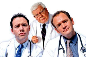 TLC. Image shows from L to R: Dr. Laurence Flynn (Reece Shearsmith), Mr. Benedict Ron (Richard Griffiths), Dr. Stephen Noble (Alexander Armstrong).