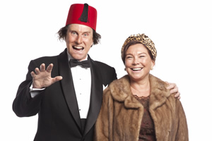 Tommy Cooper: Not Like That, Like This. Image shows from L to R: Tommy Cooper (David Threlfall), Dove Cooper (Amanda Redman). Copyright: Left Bank Pictures.