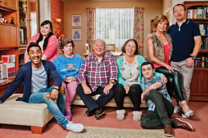 Two Doors Down. Image shows from L to R: Jaz (Harki Bhambra), Sophie (Sharon Rooney), Christine (Elaine C. Smith), Eric (Alex Norton), Beth (Arabella Weir), Ian (Jamie Quinn), Cathy (Doon Mackichan), Colin (Jonathan Watson). Copyright: BBC.