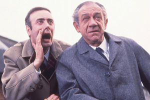 Two In Clover. Image shows from L to R: Vic Evans (Victor Spinetti), Sid Turner (Sid James). Copyright: Thames Television.