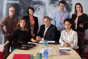 W1A. Image shows from L to R: Simon Harwood (Jason Watkins), Siobhan Sharpe (Jessica Hynes), Tracey Pritchard (Monica Dolan), Ian Fletcher (Hugh Bonneville), Will Humphries (Hugh Skinner), Lucy Freeman (Nina Sosanya), Anna Rampton (Sarah Parish). Copyright: BBC.