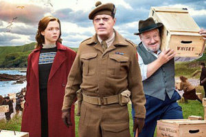 Whisky Galore!. Image shows from L to R: Peggy Macroon (Naomi Battrick), Captain Paul Wagget (Eddie Izzard), Joseph Macroon (Gregor Fisher). Copyright: Whisky Galore Movie Plc.