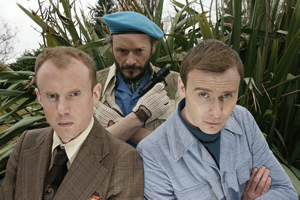Zimbani. Image shows from L to R: Chester (David McNeill), Julius Zimbani (Julian Barratt), Harry Lenarkos (Colin Hoult). Copyright: Tiger Aspect Productions.