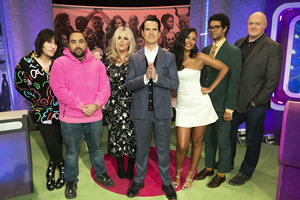 The Big Fat Quiz Of The Year. Image shows from L to R: Noel Fielding, Asim Chaudhry, Roisin Conaty, Jimmy Carr, Maya Jama, Richard Ayoade, Dara O Briain.