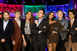 The Big Fat Quiz Of The Year. Image shows from L to R: David Mitchell, James Acaster, Stacey Solomon, Jimmy Carr, Maya Jama, Joe Lycett, Richard Ayoade.