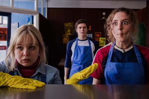 Derry Girls. Image shows from L to R: Clare Devlin (Nicola Coughlan), James Maguire (Dylan Llewellyn), Orla McCool (Louisa Harland). Copyright: Hat Trick Productions.