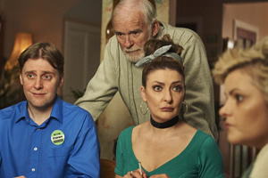 Derry Girls. Image shows from L to R: Ciaran (Jamie Beamish), Granda Joe (Ian McElhinney), Aunt Sarah (Kathy Kiera Clarke), Ma Mary (Tara Lynne O'Neill). Copyright: Hat Trick Productions.