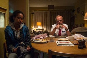 Don't Forget The Driver. Image shows from L to R: Rita (Luwam Teklizgi), Peter Green (Toby Jones).