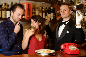 Foreigners. Image shows from L to R: Greg (Tommy Love), Josephine (Nathalie Codsi), Waiter (Stuart Walker).