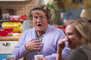 Mrs. Brown's Boys. Image shows from L to R: Agnes Brown (Brendan O'Carroll), Betty Brown (Amanda Woods).