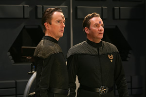 Red Dwarf. Image shows from L to R: Howard Rimmer (Mark Dexter), Rimmer (Chris Barrie). Copyright: UKTV.