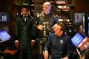 Red Dwarf. Image shows from L to R: Cat (Danny John-Jules), Kryten (Robert Llewellyn), Rimmer (Chris Barrie). Copyright: UKTV.