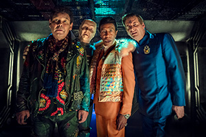 Red Dwarf. Image shows from L to R: Lister (Craig Charles), Kryten (Robert Llewellyn), Cat (Danny John-Jules), Rimmer (Chris Barrie).