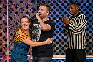 Roast Battle. Image shows from L to R: Rosie Jones, Alex Brooker, Brian Moses.