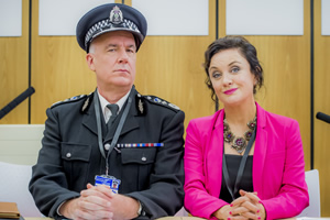 Scot Squad. Image shows from L to R: Chief Commissioner Cameron Miekelson (Jack Docherty), Barbara Edwards (Lorraine McIntosh). Copyright: The Comedy Unit.
